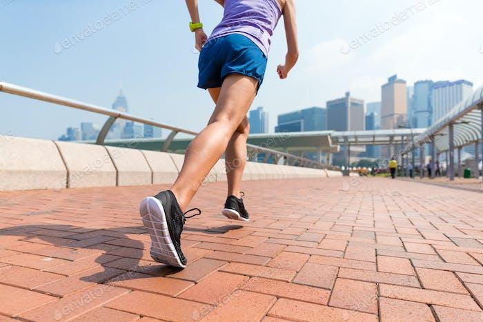 Sporty woman Jogging outside