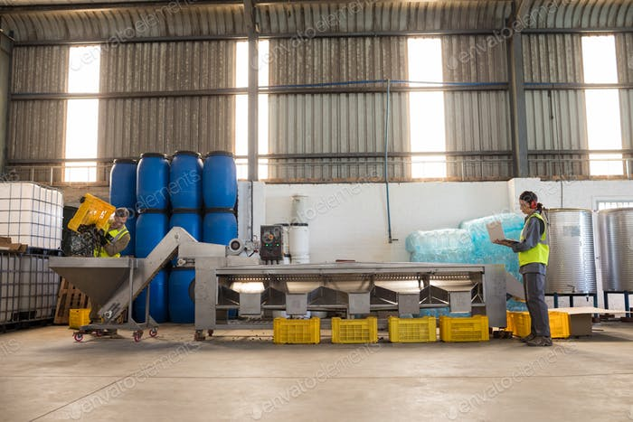 Workers working together near production line