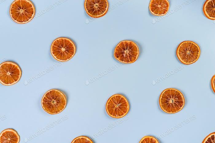 Dried slices of orange pattern on blue background