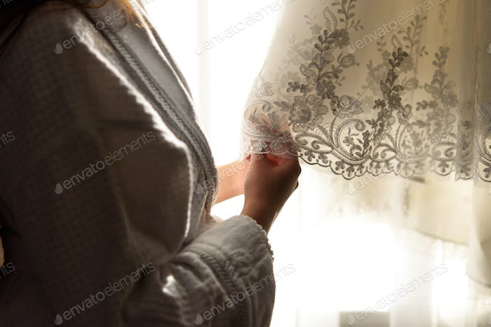 luxury wedding dress and bride in the morning at the window getting ready