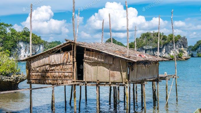 Local Bamboo Hut in Kabui Bay near Waigeo. West Papuan, Raja Ampat, Indonesia