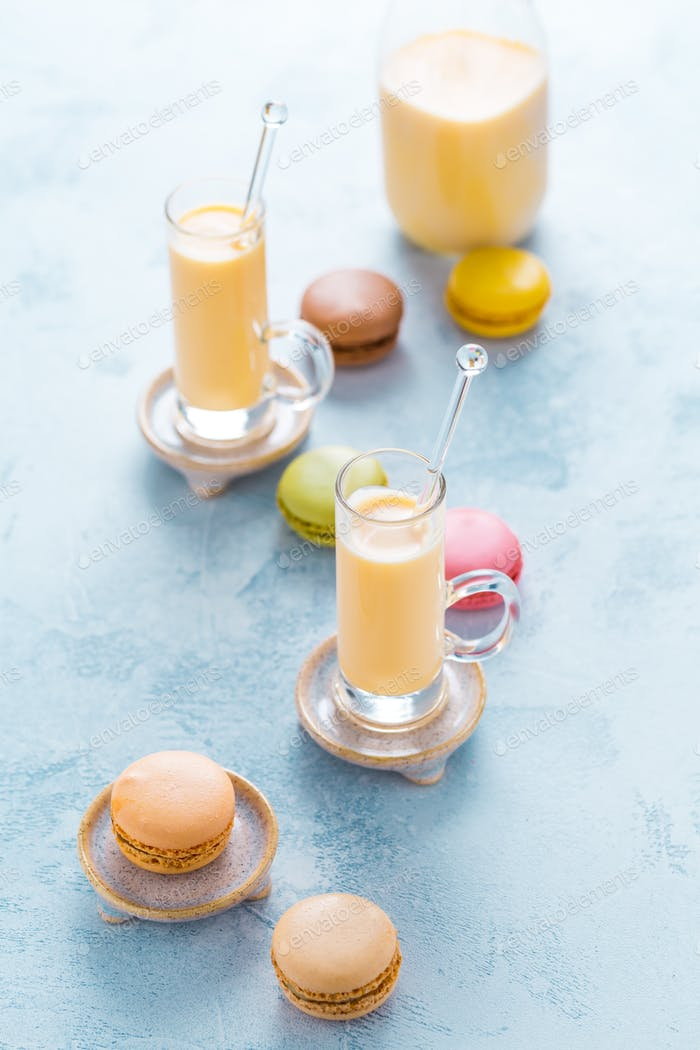 Assorted delicious French macarons with egg liqueur or eggnog