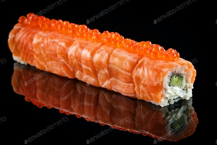 Dragon roll with salmon and red caviar