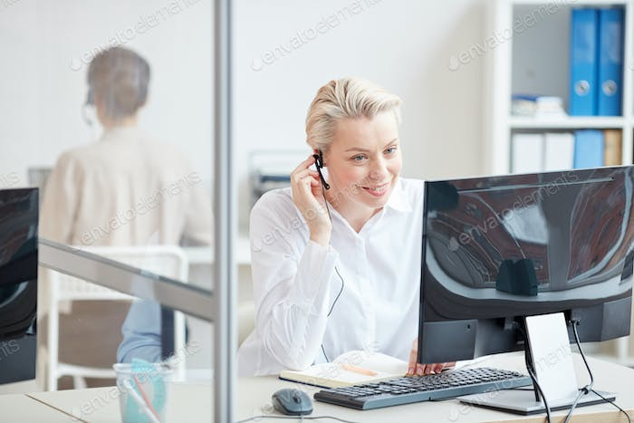 Female Operator Working in Customer Support Center