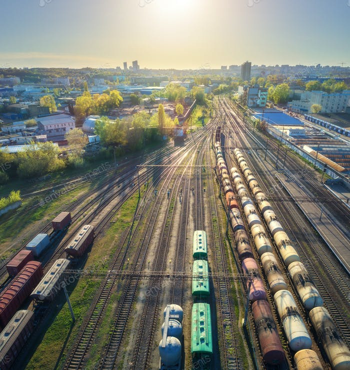 Aerial view of freight trains on railway station at sunset