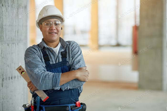 Confident Female Worker on Construction Site
