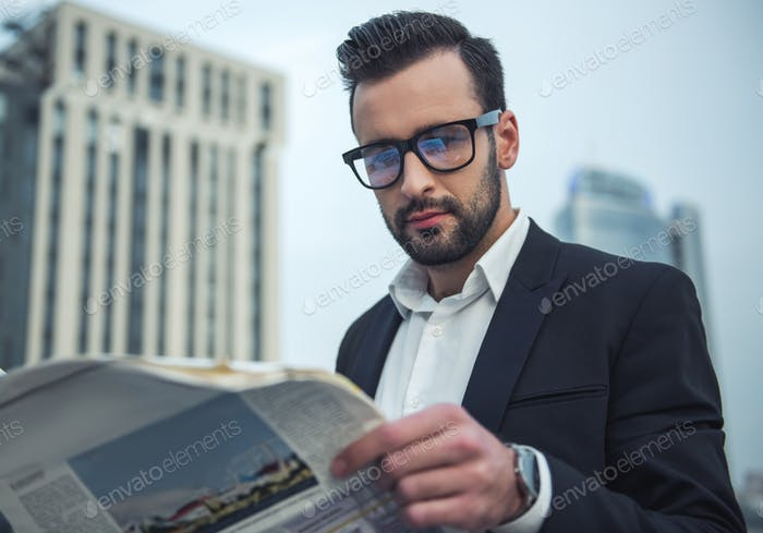 Handsome businessman outdoors