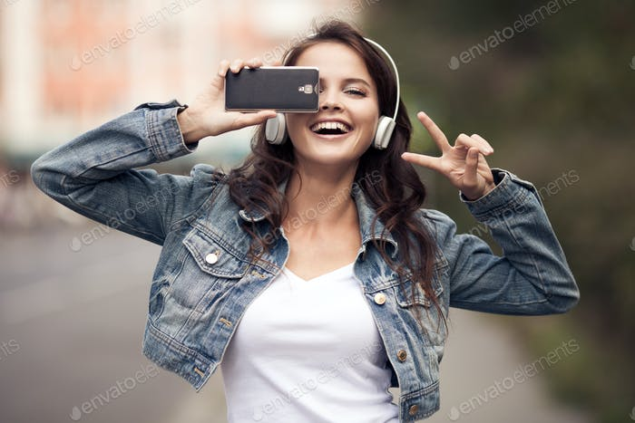 Image Of Young Happy Woman, Listening Music And Having Fun