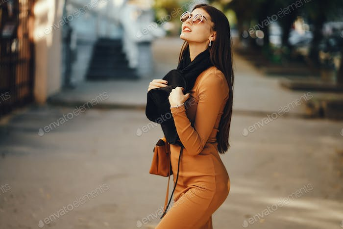 stylish girl walking through the city