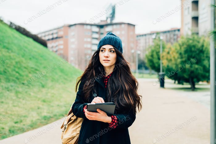 young beautiful long hair model woman living the city in winter
