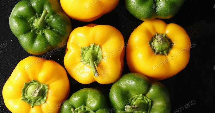 Fresh green and yellow peppers