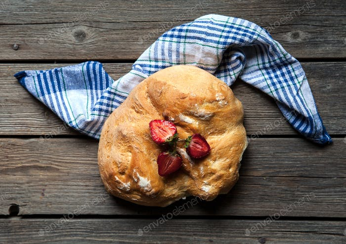 delicious breakfast with strawberries and bread on wooden background. Fruit, food