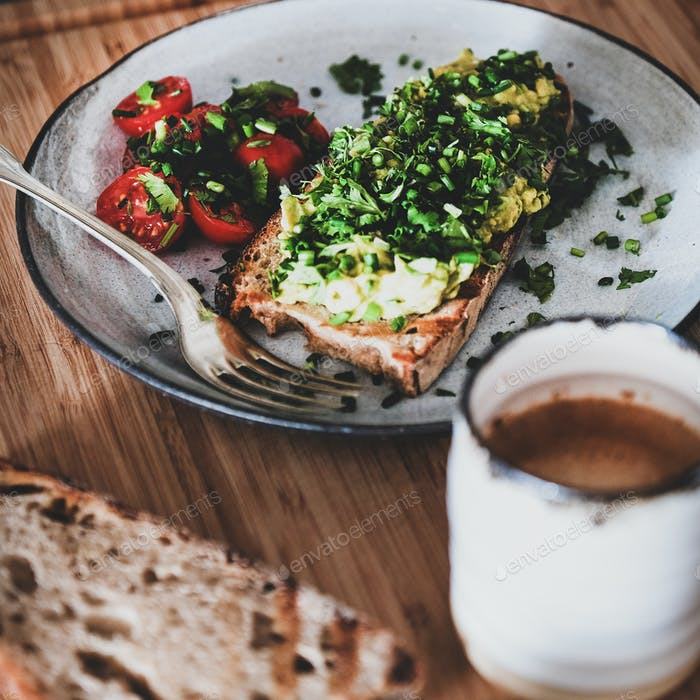 Healthy breakfast with avocado toast and coffee, square crop