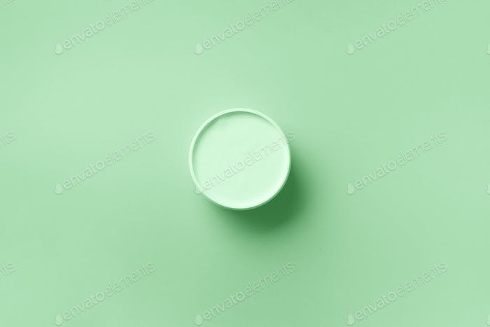 Body butter jar on in trendy mint color background with copy space. Skin care product, natural