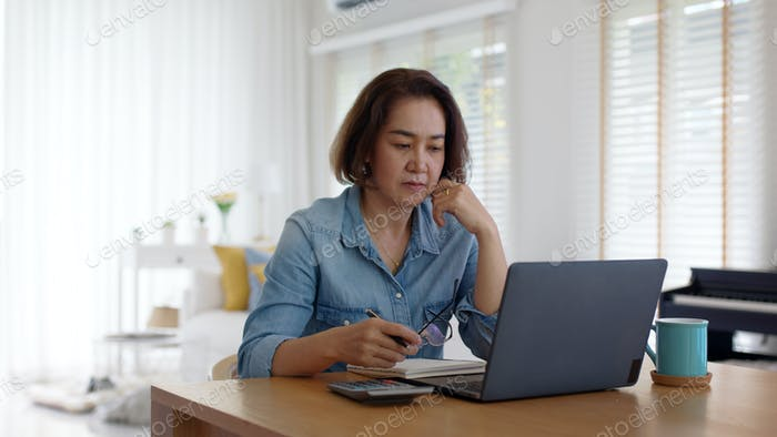 Pensive SME owner latin lady sit at home brownout work