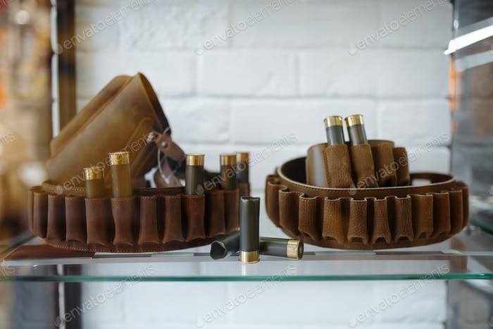 Ammunition belt, showcase in gun shop, nobody