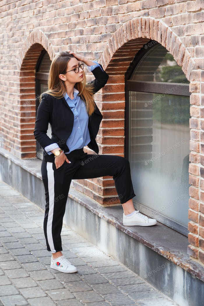 ashionable women's look with black jacket and blue blouse