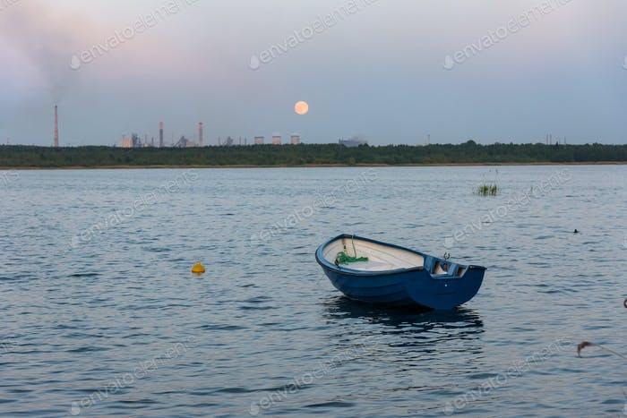 Boat on Pogoria 4 lake at moonrise