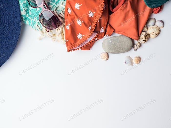 Beach female fashion accessories on white