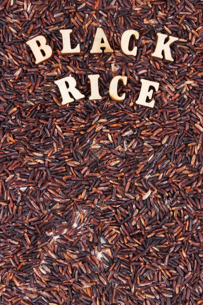 Heap of black rice as background, healthy gluten free food concept, copy space for text