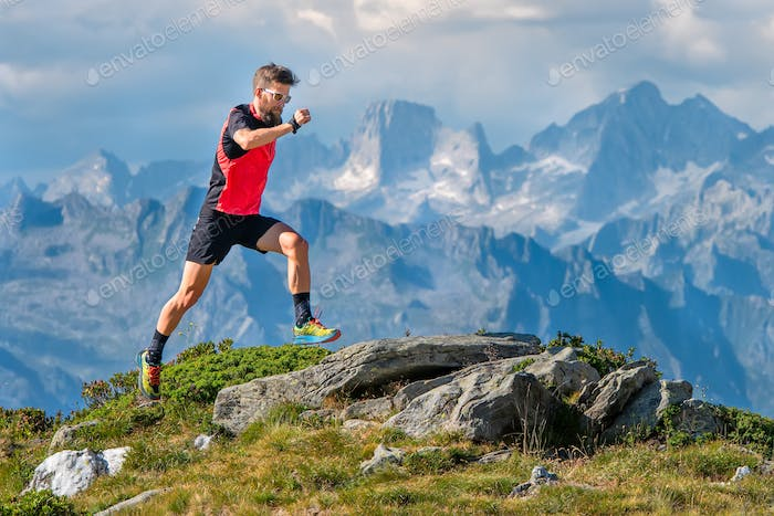A skyrunner athlete man trains in the high mountains