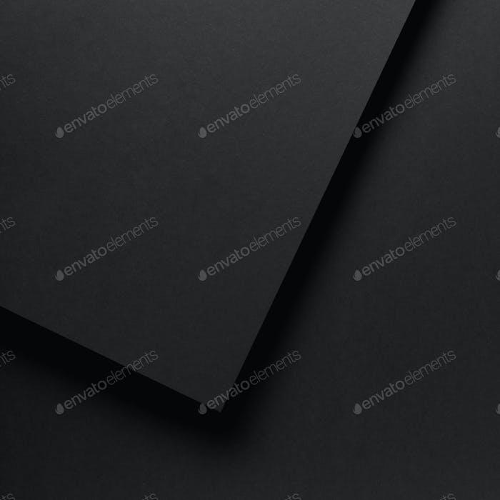 schwarzer leerer abstrakter strukturierter Papierhintergrund