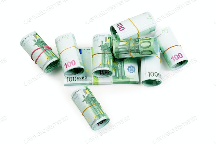 Euro banknotes in stacks and rolls isolate