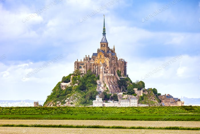Mont Saint Michel monastery landmark and green field. Normandy,