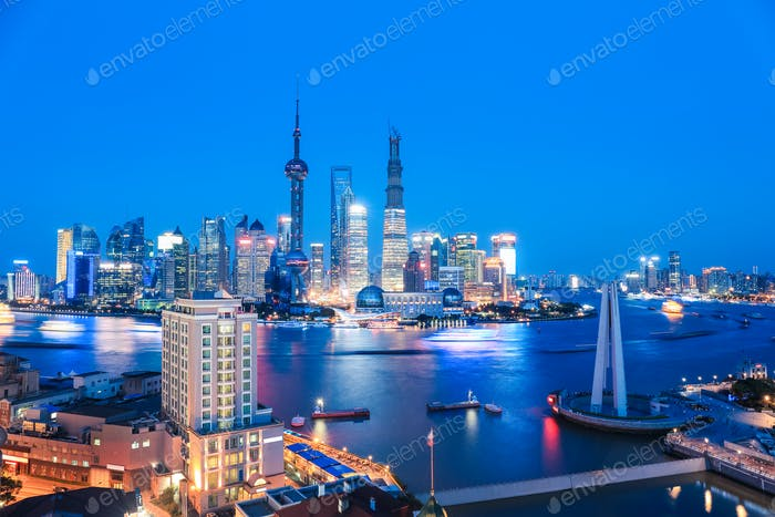 shanghai skyline and huangpu river in nightfall
