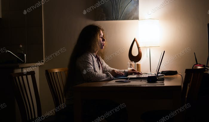 Woman sleepy and tired in internet communication overuse concept