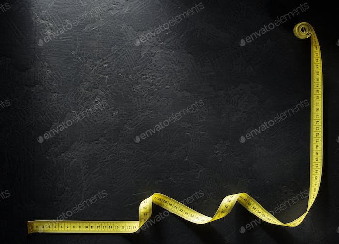tailor measuring tape on black