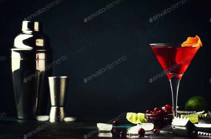 Classic alcoholic cocktail cosmopolitan with vodka, liqueur, cranberry juice, lime, ice