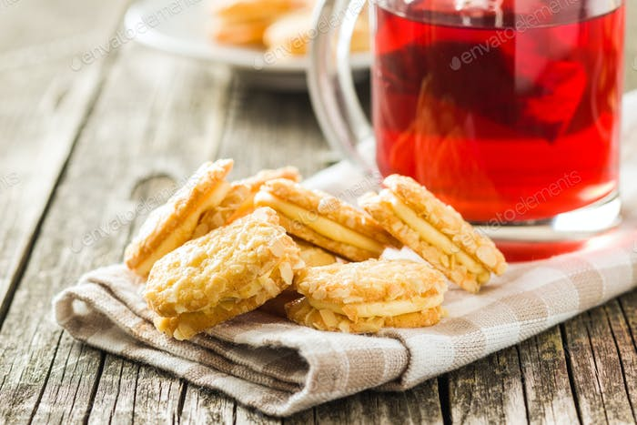 Sweet biscuits dessert and red fruity tea.
