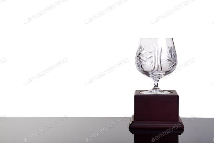 Elegant crystal cup trophy on white background flushed right