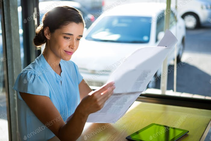 Female executive looking at documents
