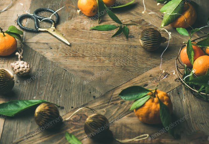 Fresh tangerines, decoration toys over rustic background, copy space