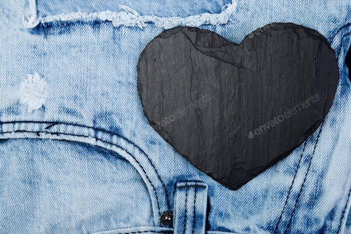 Denim. Jeans texture background. Valentine Day. Black Stone Slate heart. Copy space.