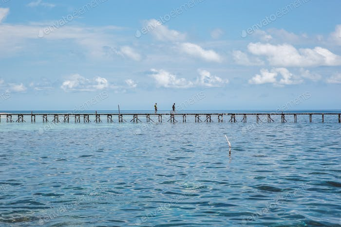 Blue Sea background with wooden dock