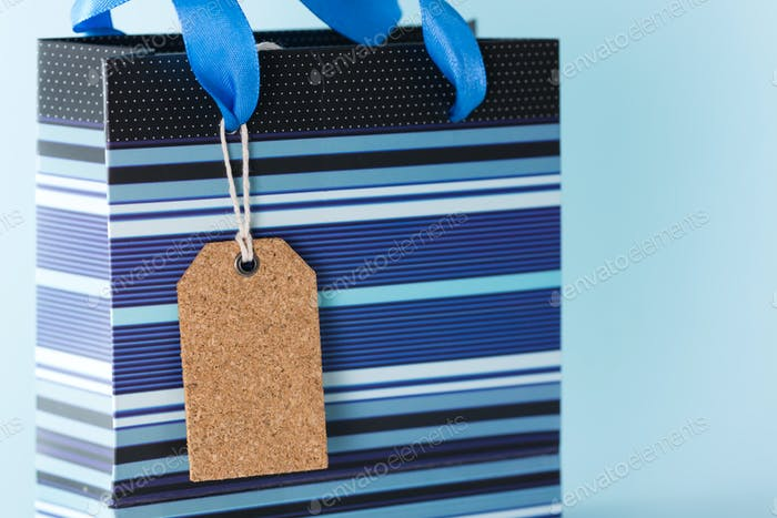 Blank tag on blue paper bag