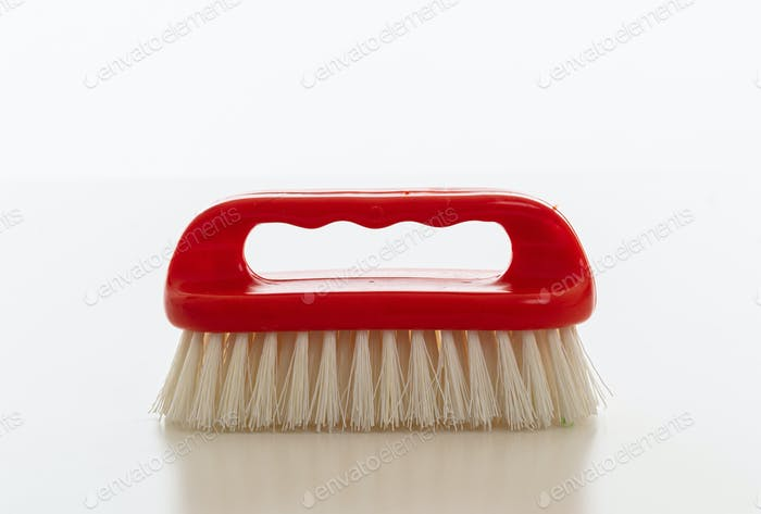 Cleaning brush red color isolated against white background.