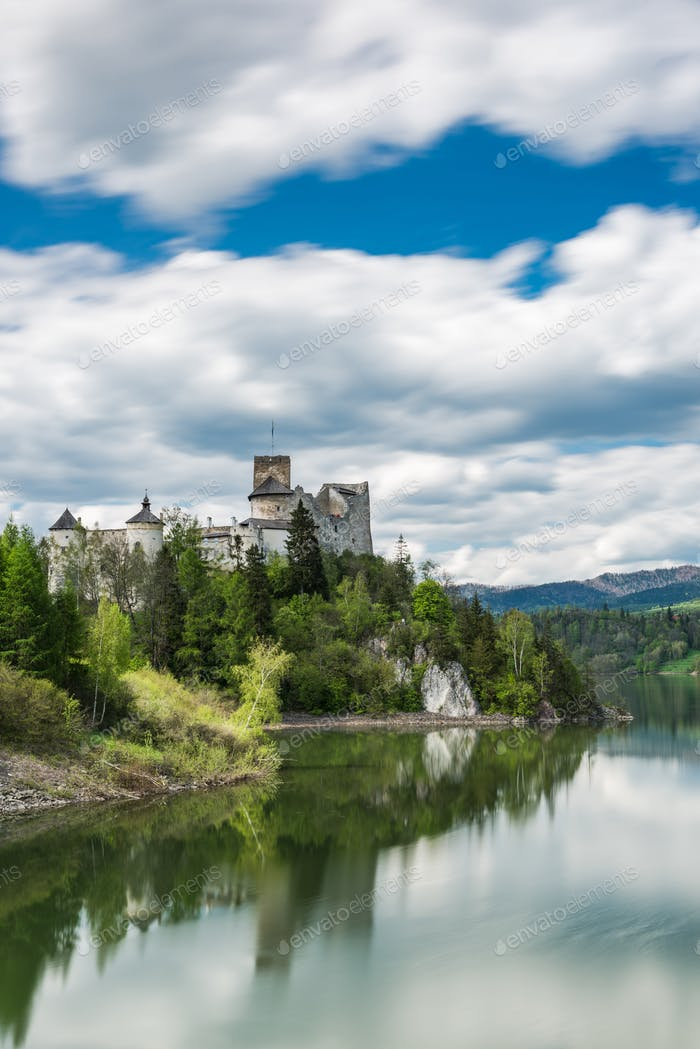Niedzica castle on hill top, lond exposure motion blur at lake C