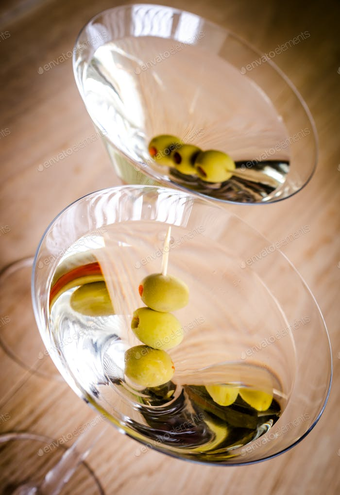 Two olive martini cocktails. The top view