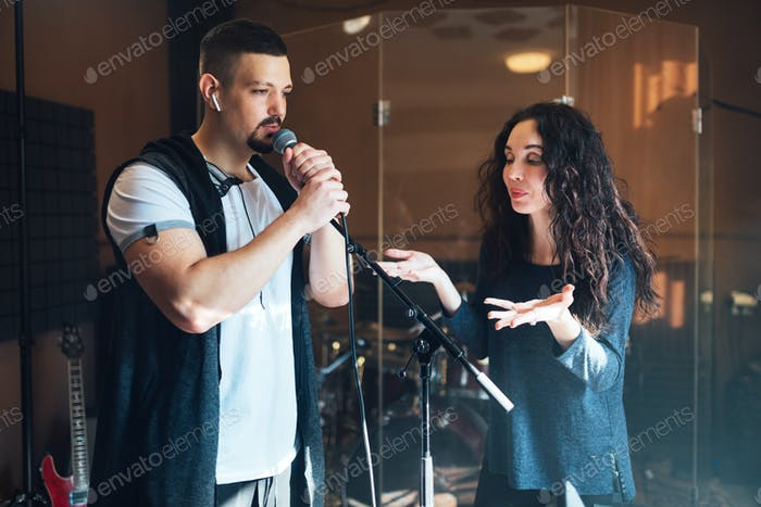 a man does chanting at a vocal lesson, the teacher points to right breath