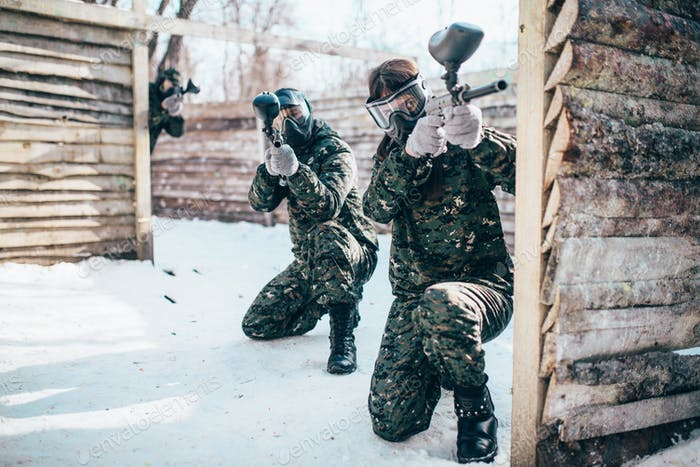 Paintball team, players in winter battle