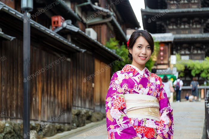 Young woman with traditional clothes in Kyoto
