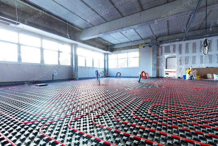 Floor heating in a new building. Interior design and finishing industry