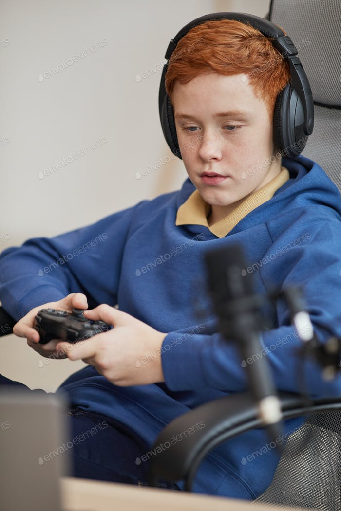 Red Haired Teenager Playing Video Games