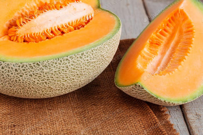 Melon sliced on wooden