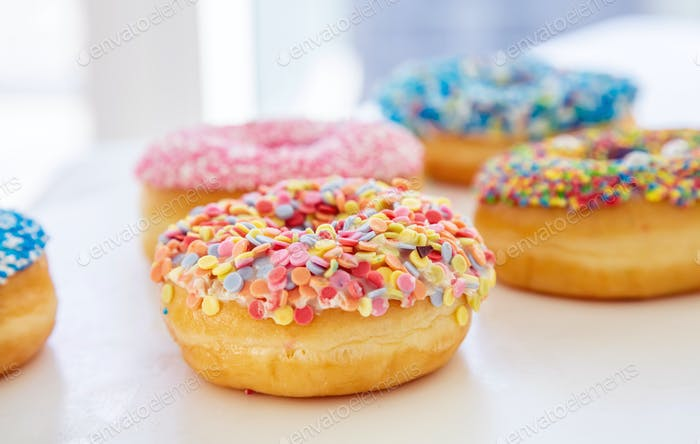 Doughnuts assorted on white. Close up view