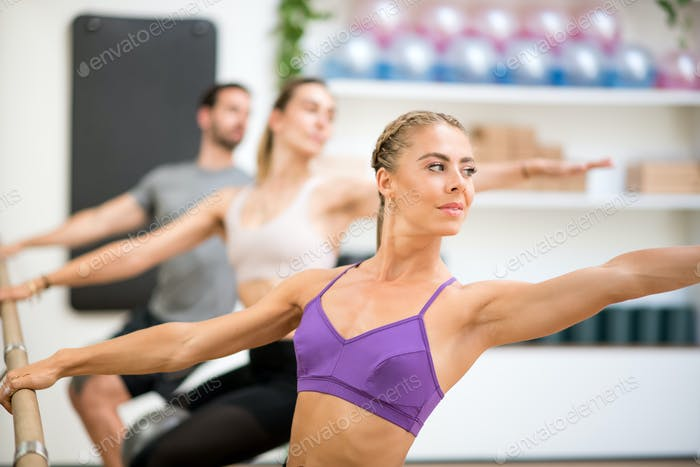 Group of people doing spinal twist exercises